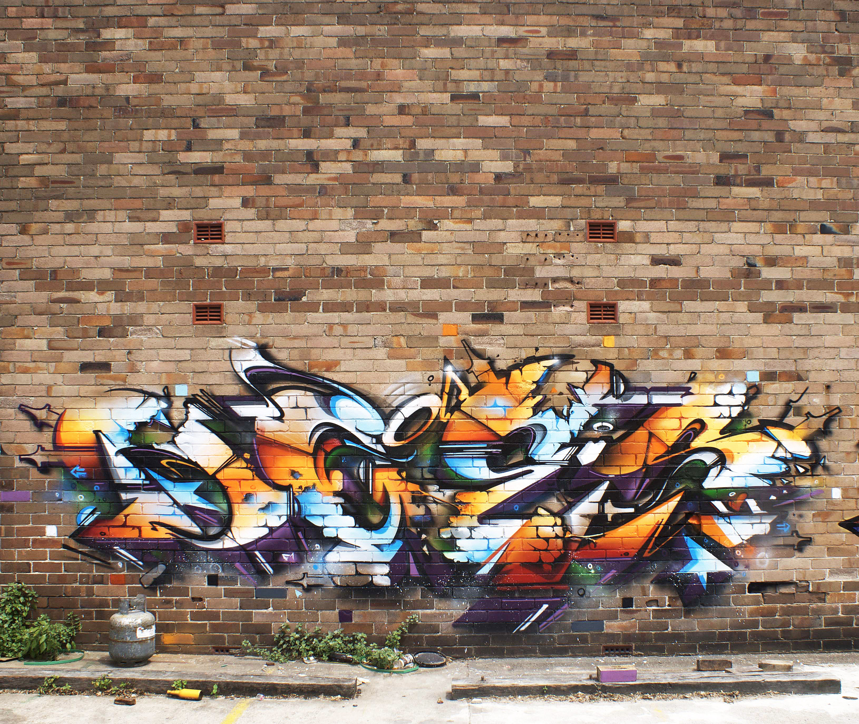 A work by Does - Sydney australia mural bricks